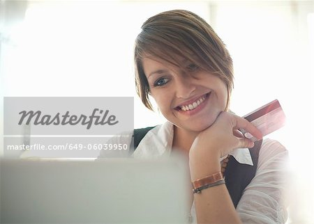 Smiling woman shopping online Stock Photo - Premium Royalty-Free, Image code: 649-06039950