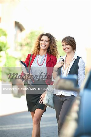 Businesswomen walking together Stock Photo - Premium Royalty-Free, Image code: 649-06039964