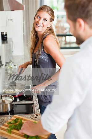 Couple cooking together in kitchen Stock Photo - Premium Royalty-Free, Image code: 649-06040120