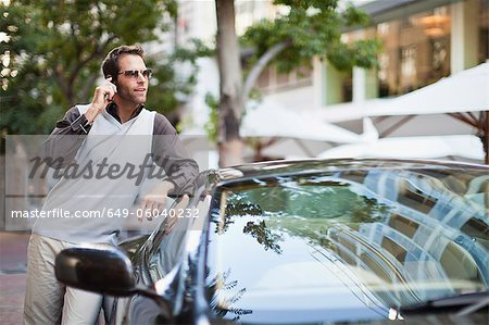 Man leaning on sports car Stock Photo - Premium Royalty-Free, Image code: 649-06040232