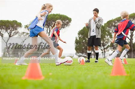 Coach training childrens soccer team Stock Photo - Premium Royalty-Free, Image code: 649-06040287