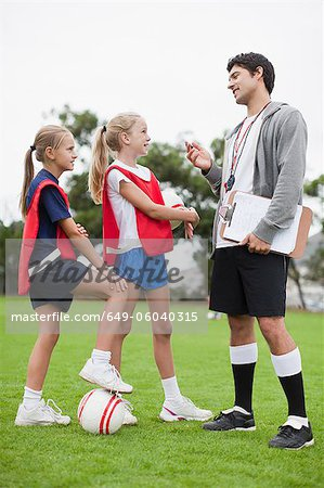 Coach talking to children on soccer team Stock Photo - Premium Royalty-Free, Image code: 649-06040315