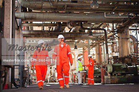 Workers walking at oil refinery Stock Photo - Premium Royalty-Free, Image code: 649-06040396