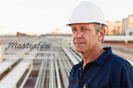 Close up of worker at oil refinery Stock Photo - Premium Royalty-Free, Image code: 649-06040421