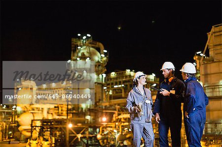 Workers talking at oil refinery Stock Photo - Premium Royalty-Free, Image code: 649-06040449