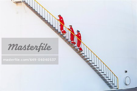 Workers on steps at chemical plant Stock Photo - Premium Royalty-Free, Image code: 649-06040537