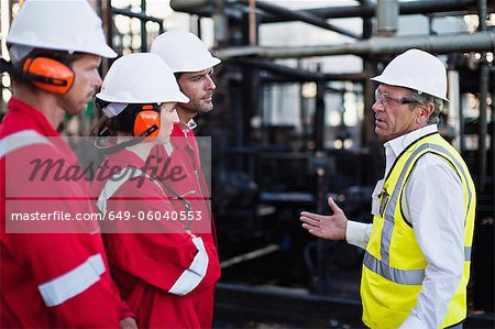 Workers talking at chemical plant Stock Photo - Premium Royalty-Free, Image code: 649-06040553