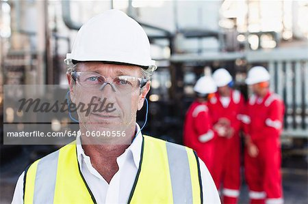 Worker standing at chemical plant Stock Photo - Premium Royalty-Free, Image code: 649-06040556