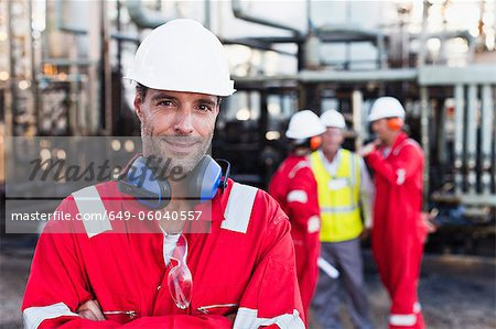 Worker standing at chemical plant Stock Photo - Premium Royalty-Free, Image code: 649-06040557