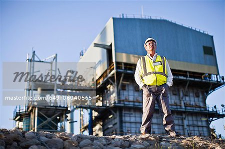 Worker standing at chemical plant Stock Photo - Premium Royalty-Free, Image code: 649-06040565