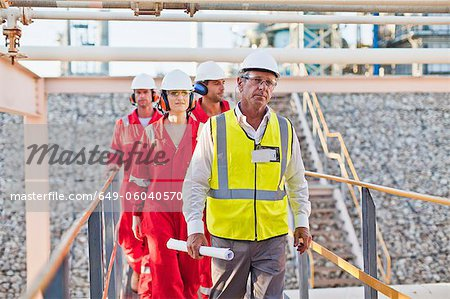 Workers walking at chemical plant Stock Photo - Premium Royalty-Free, Image code: 649-06040570