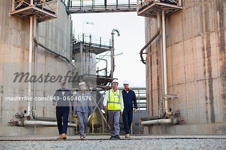 Workers walking at chemical plant Stock Photo - Premium Royalty-Free, Image code: 649-06040576