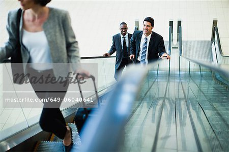Business people riding escalator Stock Photo - Premium Royalty-Free, Image code: 649-06040641