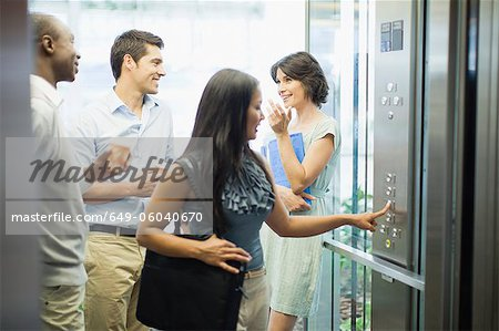 Business people riding glass elevator Stock Photo - Premium Royalty-Free, Image code: 649-06040670
