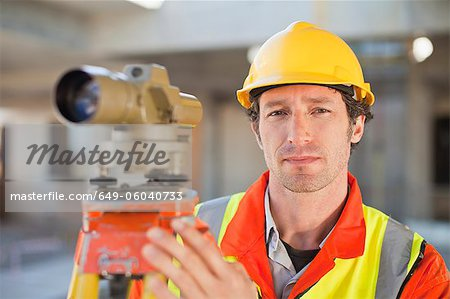 Worker using equipment on site Stock Photo - Premium Royalty-Free, Image code: 649-06040733