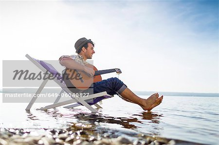 Man relaxing in lawn chair in creek Stock Photo - Premium Royalty-Free, Image code: 649-06040827