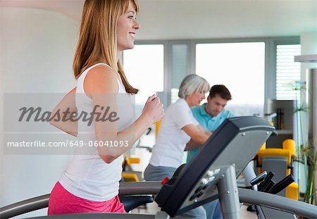 Woman using treadmill in gym Stock Photo - Premium Royalty-Free, Image code: 649-06041093