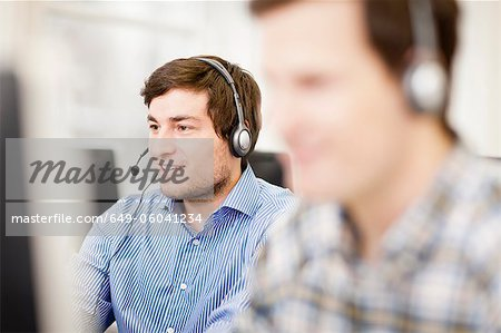 Businessman working in headset Stock Photo - Premium Royalty-Free, Image code: 649-06041234