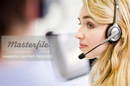 Business people working in headsets Stock Photo - Premium Royalty-Free, Image code: 649-06041251