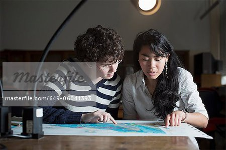 Students reading map in class Stock Photo - Premium Royalty-Free, Image code: 649-06041393