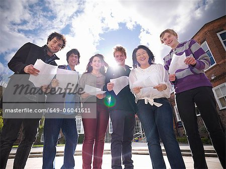 Students reading grades together Stock Photo - Premium Royalty-Free, Image code: 649-06041611