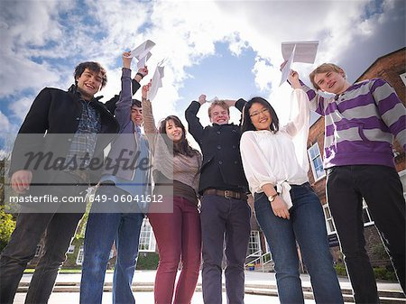 Students with grades cheering at school Stock Photo - Premium Royalty-Free, Image code: 649-06041612