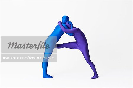 Men in bodysuits making the letter A Stock Photo - Premium Royalty-Free, Image code: 649-06041709