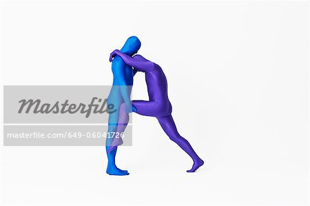 Men in bodysuits making the letter R Stock Photo - Premium Royalty-Free, Image code: 649-06041726