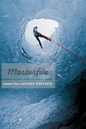Climber abseiling into ice cave Stock Photo - Premium Royalty-Free, Image code: 649-06041878