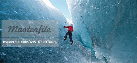 Climber climbing out of ice cave Stock Photo - Premium Royalty-Free, Image code: 649-06041882