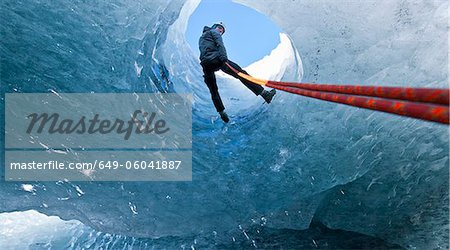 Climber abseiling into ice cave Stock Photo - Premium Royalty-Free, Image code: 649-06041887