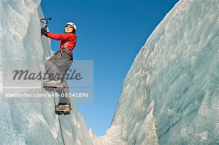 Climber scaling glacier wall Stock Photo - Premium Royalty-Free, Image code: 649-06041896