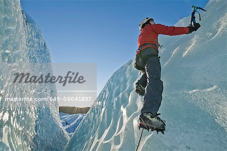 Climber scaling glacier wall Stock Photo - Premium Royalty-Free, Image code: 649-06041897