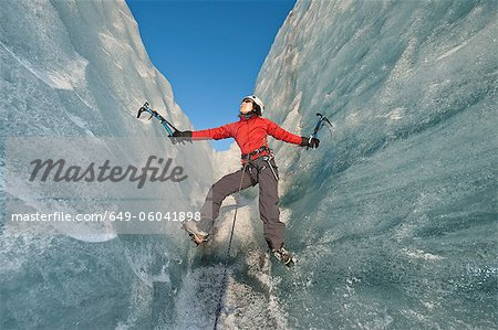 Climber scaling glacier wall Stock Photo - Premium Royalty-Free, Image code: 649-06041898