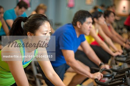 People using spin machines in gym Stock Photo - Premium Royalty-Free, Image code: 649-06041953