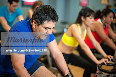 People using spin machines in gym Stock Photo - Premium Royalty-Free, Image code: 649-06041955