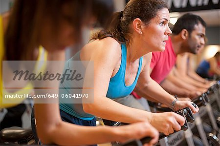 People using spin machines in gym Stock Photo - Premium Royalty-Free, Image code: 649-06041970