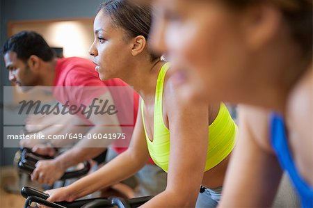 People using spin machines in gym Stock Photo - Premium Royalty-Free, Image code: 649-06041975