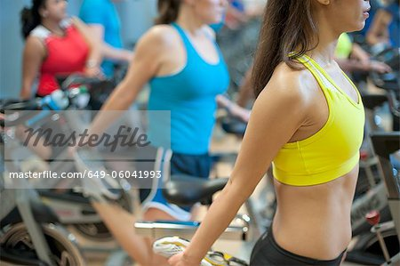 People stretching on spin machines Stock Photo - Premium Royalty-Free, Image code: 649-06041993