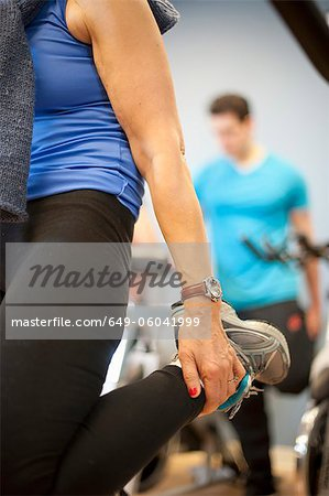 Close up of woman stretching in gym Stock Photo - Premium Royalty-Free, Image code: 649-06041999
