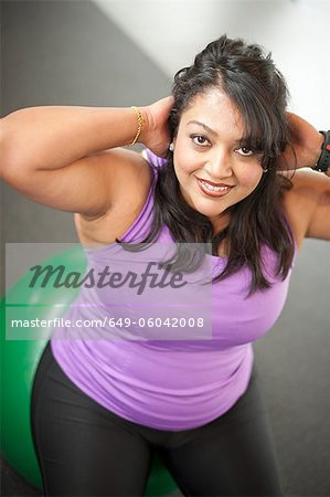 Woman using exercise ball in gym Stock Photo - Premium Royalty-Free, Image code: 649-06042008