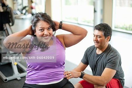 Woman working with trainer in gym Stock Photo - Premium Royalty-Free, Image code: 649-06042009