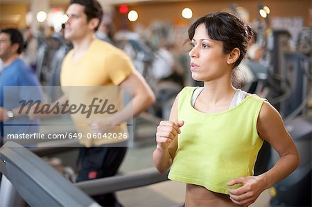 People using treadmills in gym Stock Photo - Premium Royalty-Free, Image code: 649-06042026