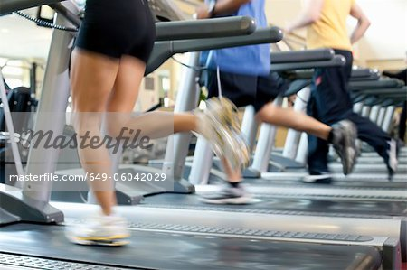 Blurred view of people on treadmills Stock Photo - Premium Royalty-Free, Image code: 649-06042029