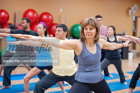 People practicing yoga in studio Stock Photo - Premium Royalty-Free, Image code: 649-06042044