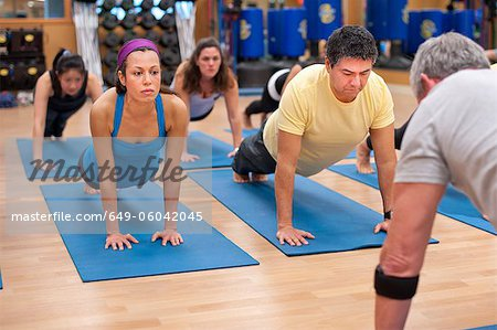 People practicing yoga in studio Stock Photo - Premium Royalty-Free, Image code: 649-06042045