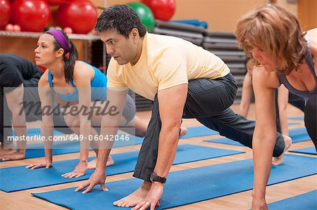 People practicing yoga in studio Stock Photo - Premium Royalty-Free, Image code: 649-06042046