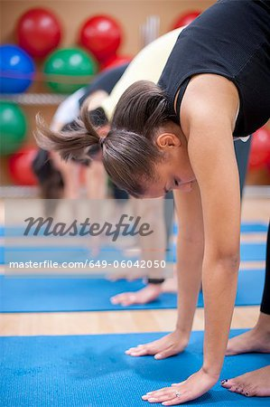People practicing yoga in studio Stock Photo - Premium Royalty-Free, Image code: 649-06042050