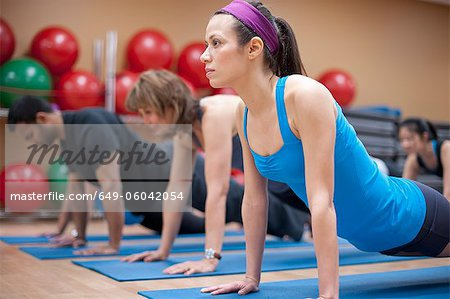 People practicing yoga in studio Stock Photo - Premium Royalty-Free, Image code: 649-06042054