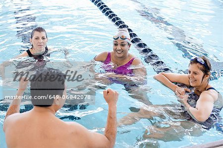 People relaxing in swimming pool Stock Photo - Premium Royalty-Free, Image code: 649-06042078